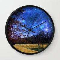 battlestar galactica Wall Clocks featuring Reservoir Galactica  by DeLayne