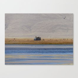 People working on the land at the shore of bulunkul, Tajikistan Canvas Print