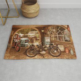 Nostalgic garage with tractor and motorcycle Rug