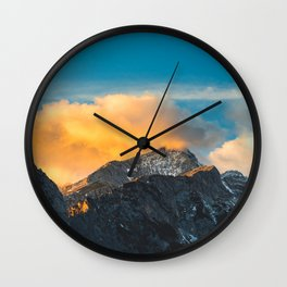 Last light on mountains before sunset Wall Clock
