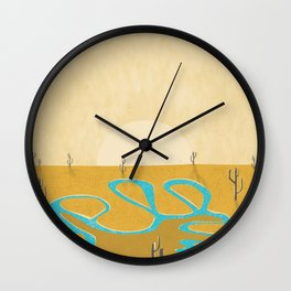 A stream of water in warm yellow desert Wall Clock