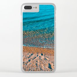 stony beach in orange colors with clean water Clear iPhone Case