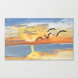 Birds flying over the sunset Canvas Print