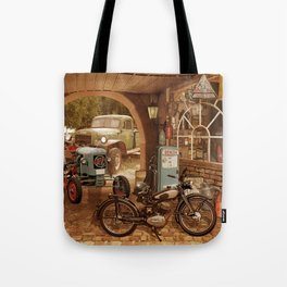 Nostalgic garage with tractor and motorcycle Tote Bag