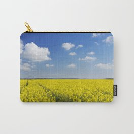 Path through blooming canola under a blue sky with clouds Carry-All Pouch
