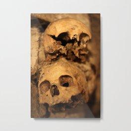 Skulls in the catacombs in Paris, France. Metal Print