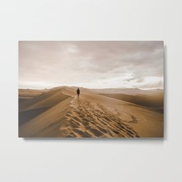 Young woman treks across sand dunes in the Hucachina desert, Peru Metal Print
