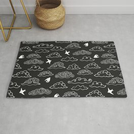 Black Doodle clouds and swallows. Cloudscape pattern with birds. Rug