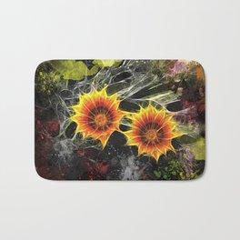 Glowing yellow daisies on black Bath Mat