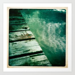 dock water and clouds Art Print
