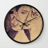 katniss Wall Clocks featuring Katniss Everdeen by KOverbee