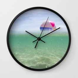 above and below clear blue sea with beach ball Wall Clock