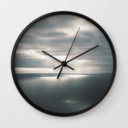 Sunbeams in the big ocean Wall Clock