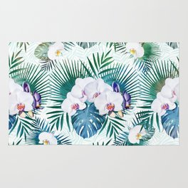 Tropical leaves and orchid flowers design Rug