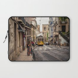 Tram 28 transports tourists through Alfama district in Lisbon, Portugal Laptop Sleeve