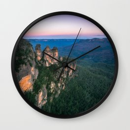 Cold morning but warm sunrise colors in the sky at Three Sisters in Blue Mountains. Wall Clock