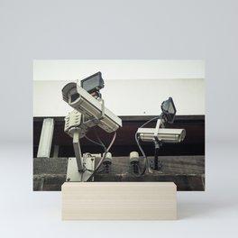 CCTV cameras on a wall for surveillance Mini Art Print