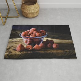 Raspberries for breakfast, raspberries on a wood table top Rug