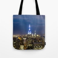 new york city Tote Bags featuring New York City, New York by Stuart Saunders