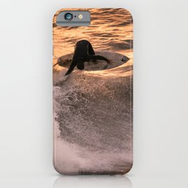 Surfer grabs air on wave at sunset iPhone Case