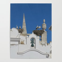 storks build nests on the church in the old town of faro, portugal, europe Poster
