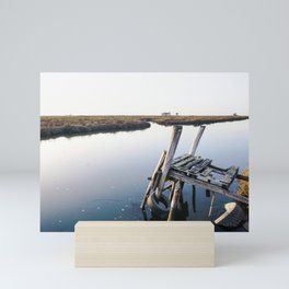 Weathered and rickety wooden dock almost collapsing in the Aveiro lagoon. Mini Art Print