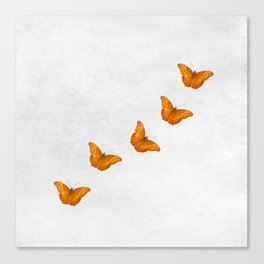 Beautiful butterflies on a textured white background Canvas Print