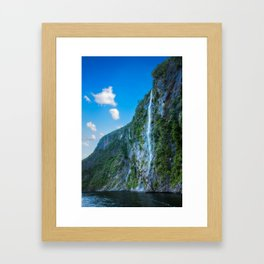 One of the numerous waterfalls falling down the sheer cliffs at Milford Sound. Framed Art Print
