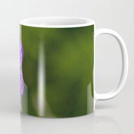 A Cranesbill Geranium blooms in a Spring Rainshower Coffee Mug