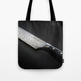Knife with drops of water isolated on a black background Tote Bag