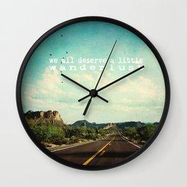 we all deserve a little wanderlust Wall Clock