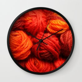 Many Balls of Wool in Shades of Red Wall Clock