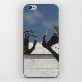 Hands and bird iPhone Skin