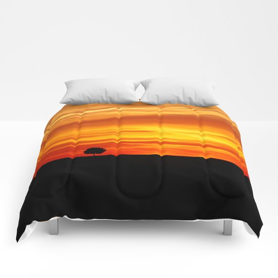 Dramatic sundown Comforters