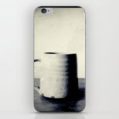 Cup of coffee on a table iPhone Skin