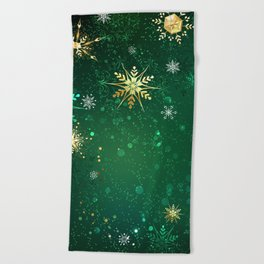Gold Snowflakes on a Green Background Beach Towel