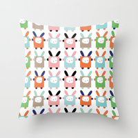 bunnies Throw Pillows featuring bunnies by PETITE PATATE