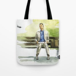 Forrest Gump (Tom Hanks) sitting on a bench with a flying feather Tote Bag