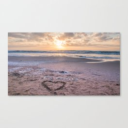 Love note Te Amo with the heart drawing on the beach at sunrise Canvas Print
