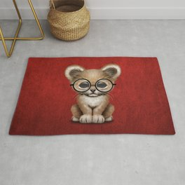 Cute Baby Lion Cub Wearing Glasses on Red Rug
