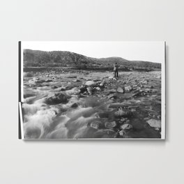 Man with rifle stands in mountain stream as it floods, east of Palmdale, California, ca.1920 Metal Print