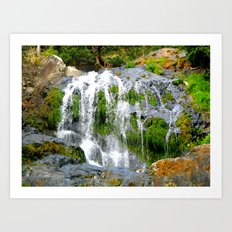 Waterfall over green rocks Art Print