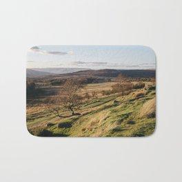 Trees on a hillside at sunset. Upper Padley, Derbyshire, UK. Bath Mat