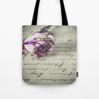 letter Tote Bags featuring Love letter by Maria Heyens