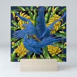 Hyacinth Macaws and bananas Stravaganza (black background). Mini Art Print