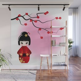 Japanese kokeshi doll at sakura blossoms Wall Mural