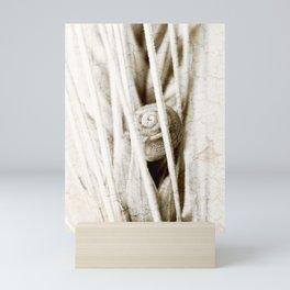 The snail in grain Mini Art Print