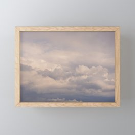 Clouds in the blue sky indicate the arrival of a disturbance Framed Mini Art Print