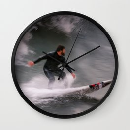 Surfer riding a wave Wall Clock