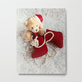 A soft bear toy on the snow background Metal Print